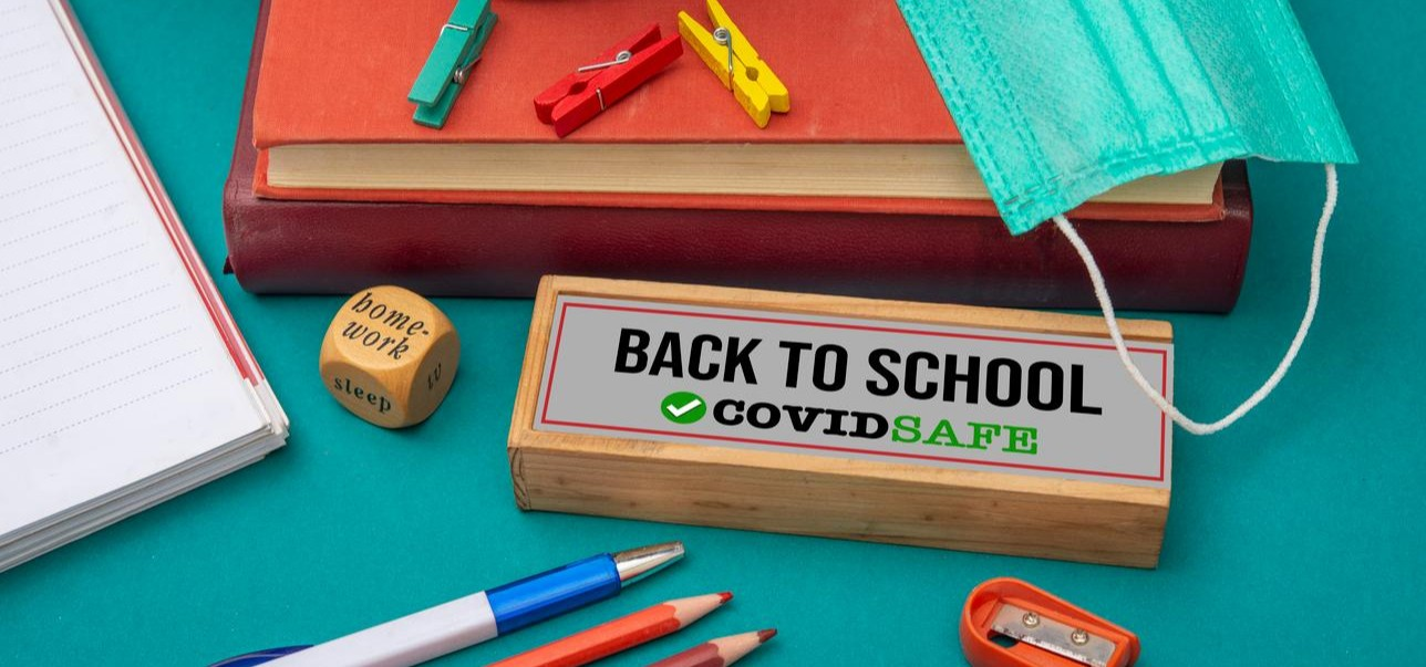 School Supplies with Back to School Covid Safe sign